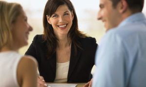 Couple talking to a consultant --- Image by © Whisson/Jordan/Corbis